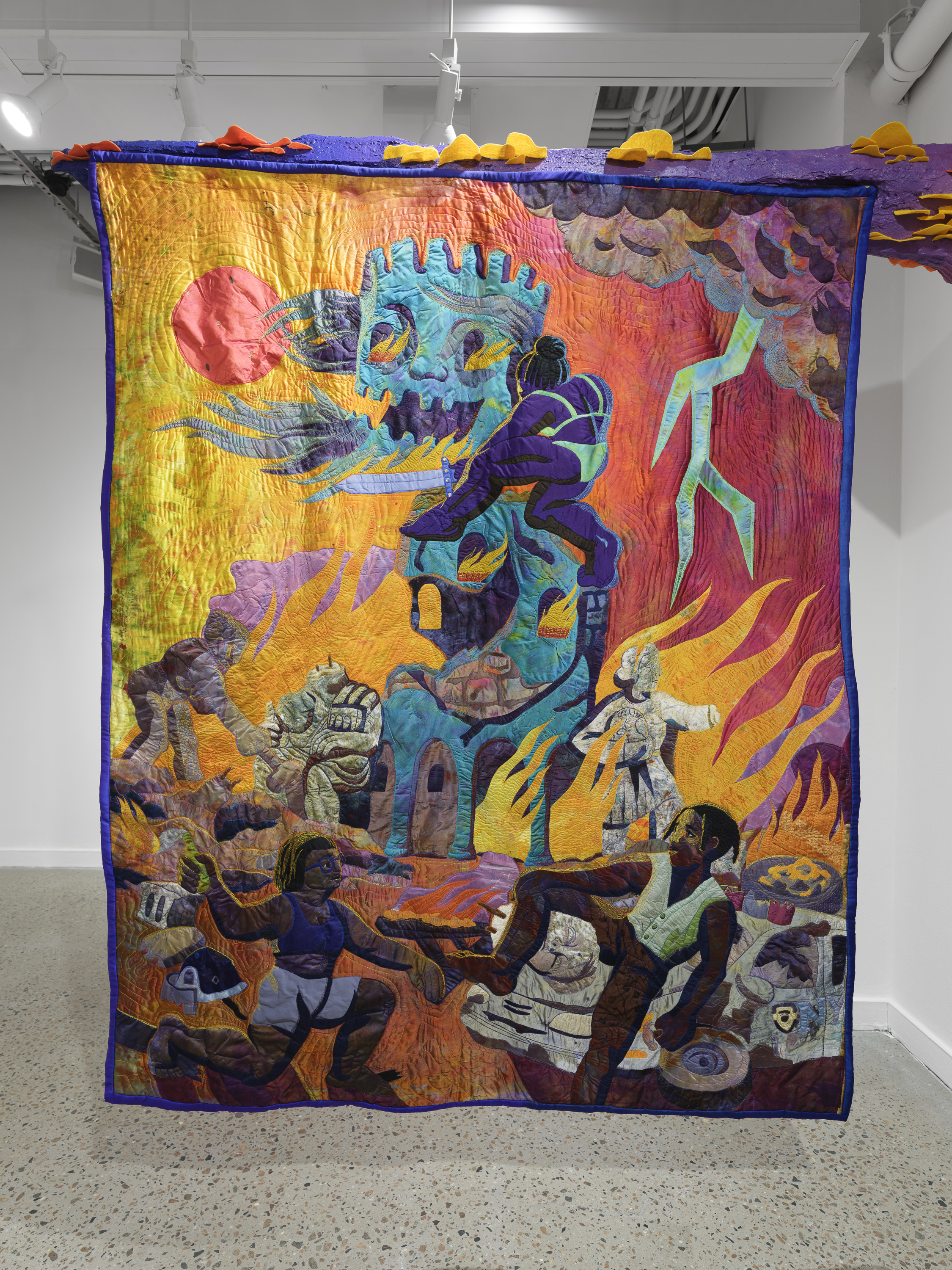 Colorful artwork of a woman slaying a skeleton surrounded by fire and other people.